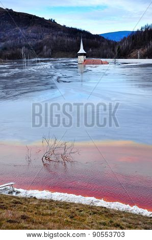 Abandoned Church Flooded By A Lake Full With Chemical Residuals. Geamana, Rosia Montana