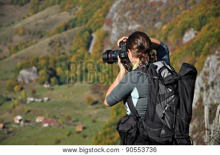 Woman Photographer Taking A Photo In The Mountains At Autumn