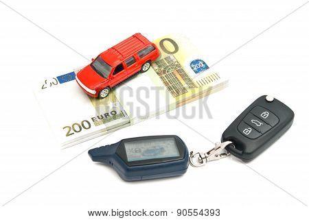Car Keys, Red Car And Banknotes