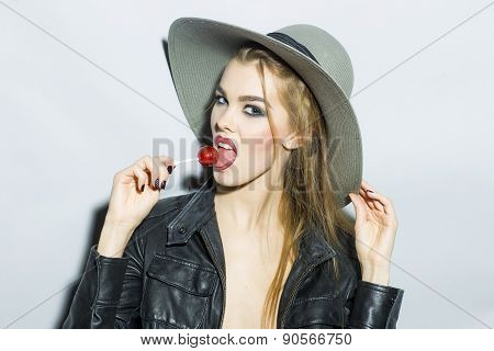 Impetuous Young Blonde Woman Portrait With Sugar Candy