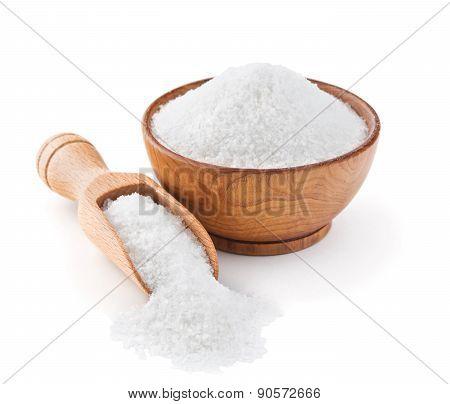 Regular table salt in a wooden bowl