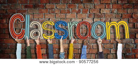 Hands Holding Classroom Word on Brick Wall