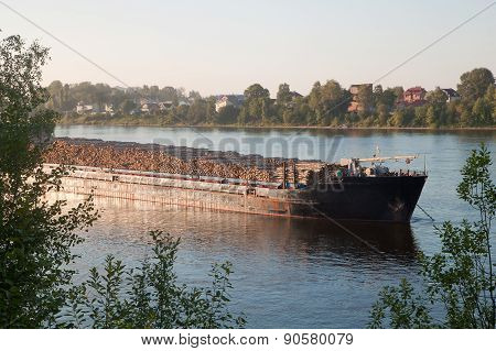 A Big Ship Carrying Wood