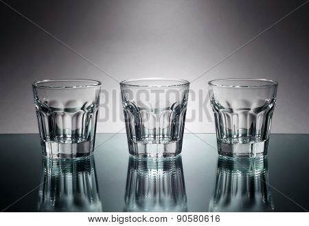 Three Vodka Glasses At Mirror
