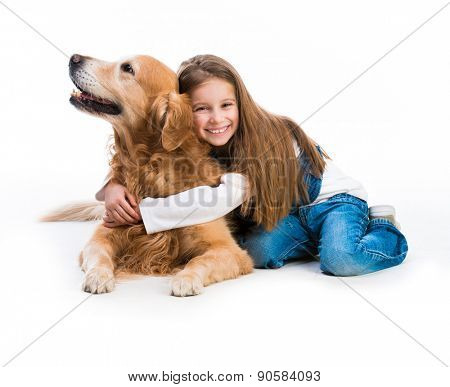 Happy little girl with her dog golden retriever in the studio. Isolated on white
