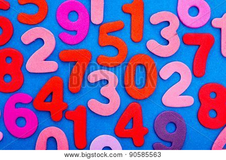 Variety Of Numbers In Red And Pink On Blue