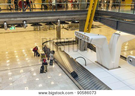Passenger At The Beggage Belt At Terminal 4 At Barajay Airport