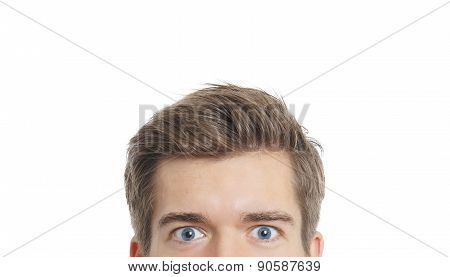 upper part of a male face with staring eyes poster