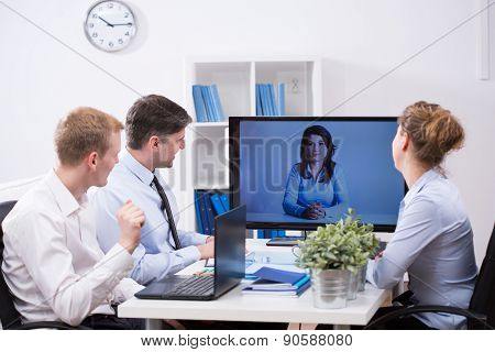 Modern office - business team having web conference poster
