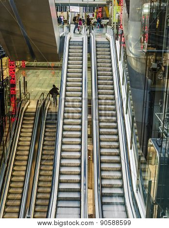 Passenger In Terminal 4 On A Moving Staircase