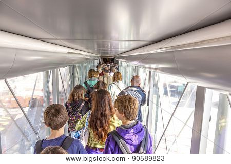 Passenger Boarding The Plane At Terminal 4