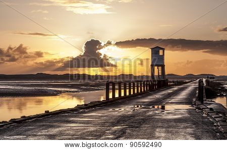 The Causeway to Holy Island at Sunrise, Northumberland, England.
