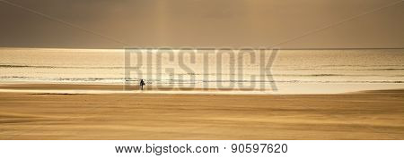 Inspirational Surfing Landscape Panoramic, Lone Surfer By Tide At Sunset.