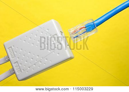 Twisted pair (patch cord) blue network Internet cable is inserted into the slot of the splitter on a