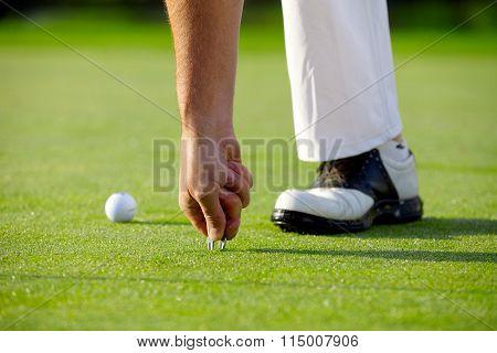 Golfer With Pitchfork