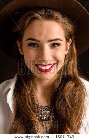 Beautiful model lady in hat in studio