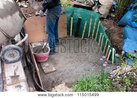 Man Building Artificial Pond