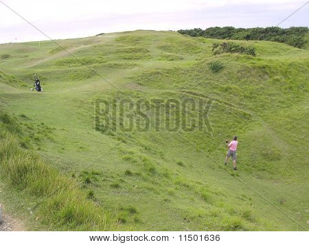 Golfer Striking Hard