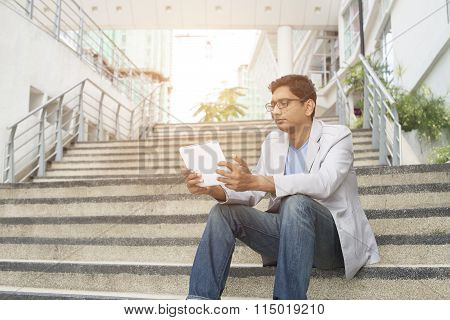Indian Male Using Tablet Outdoor
