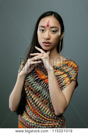 beauty young asian girl with make up like Pocahontas, red indians woman long hair closeup