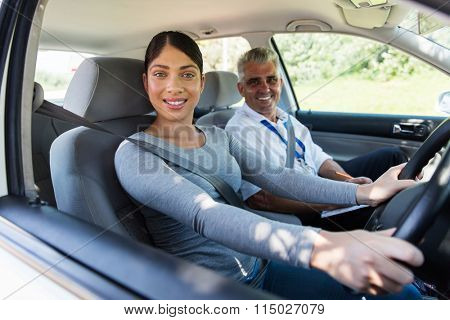 beautiful young woman taking driving lessons