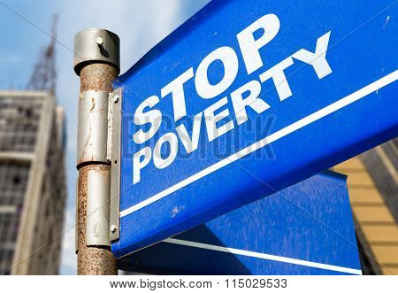 Stop Poverty written on road sign