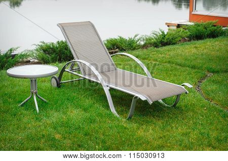 Chaise Lounge On The Banks Of The River
