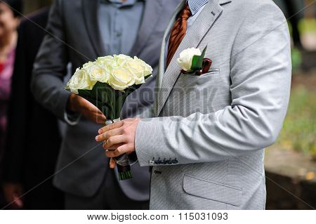 Bride With A Wedding Bouquet And Buttonhole