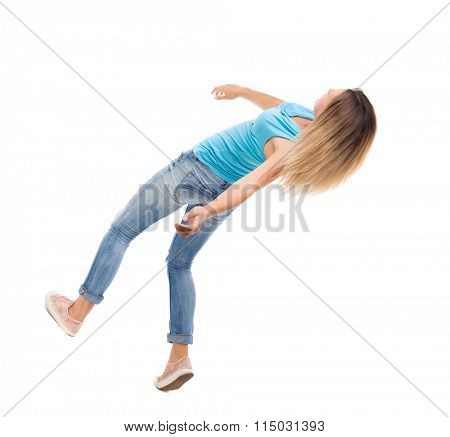 Slipping girl falls. Balancing young woman.  or dodge falling woman. Rear view people collection.   Isolated over white background. The blonde in a blue sweater in the time of the fall.
