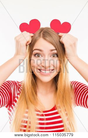 Pretty Girl Holding Two Paper Hears Like Ears, Close Up Photo