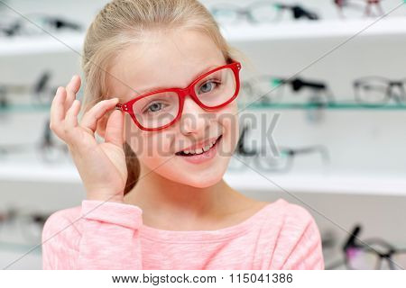 little girl in glasses at optics store