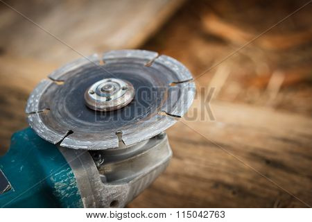 the grinder tool on ground for woodwork