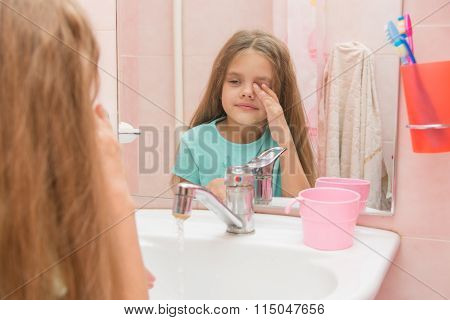 Girl Wet Hand Wipes The Sleep From His Eyes In The Bathroom