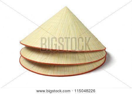 Stack of Three Oriental Straw Hats on White Background