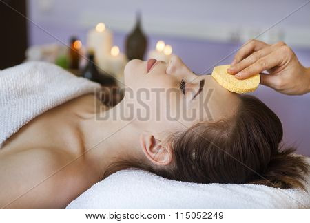 Relaxed Woman With A Deep Cleansing Nourishing Face Mask Applied To Her Face