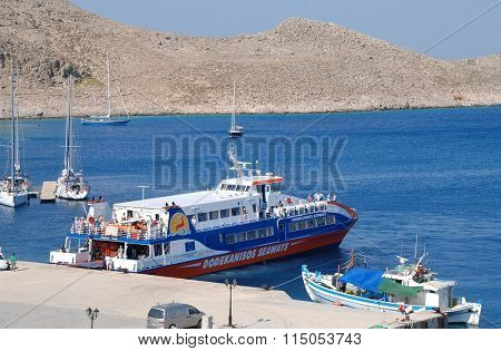 HALKI, GREECE - JUNE 16, 2015: Dodekanisos Seaways catamaran ferry Dodekanisos Express moored at Emborio harbour on the Greek island of Halki. The 40mtr vessel was built in 2000 in Norway.