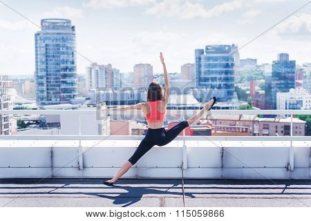 Yoga And Meditation In A Modern Urbanistic City. Young Attractive Girl - Yoga Meditates Against Mode