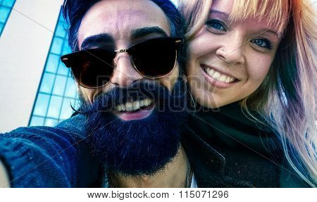 Bearded Man And Girlfriend Taking Selfie Playing Piggyback - Hipsters Couple Having Fun With Mobile