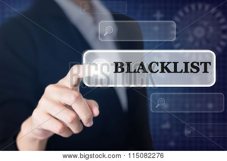 Businessman pressing a BLACKLIST concept button.