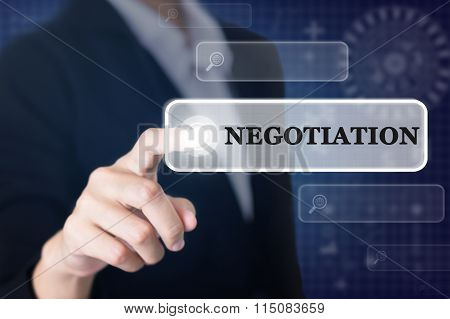 Businessman pressing a NEGOTIATION concept button.