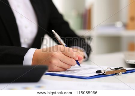 Hand Of Businesswoman Filling And Signing With Silver Pen Partnership Agreement