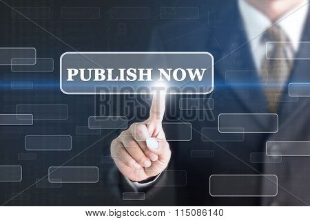 Businessman pressing PUBLISH NOW concept button.