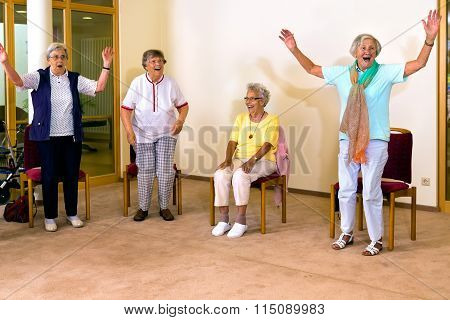 Senior Women Standing And Sitting For Exercise