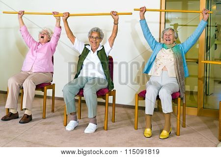 Three Happy Elderly Ladies Doing Exercises
