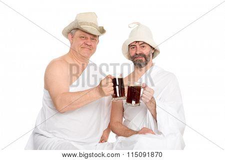 Men in traditional bathing attire drink kvas - russian bread juice. From a series of Russian bath.