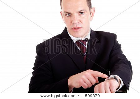 Upset Businessman Pointing To The Watch, Isolated On White Background. Studio Shot.