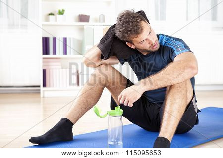 Athletic Man Resting After His Indoor Exercise