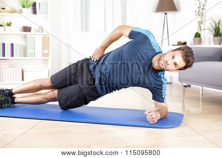 Healthy Man Doing Side Plank Exercise On A Mat