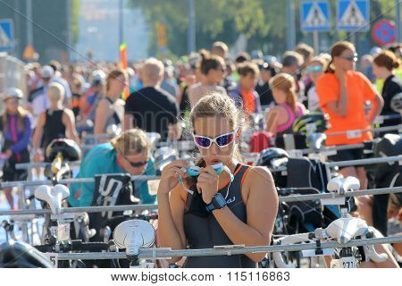Beautiful Woman Fixing The Swim Goggles Before The Triathlon Race