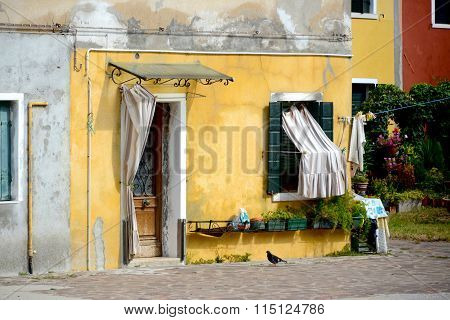Colorful Yellow Building Corner In Burano, Italy
